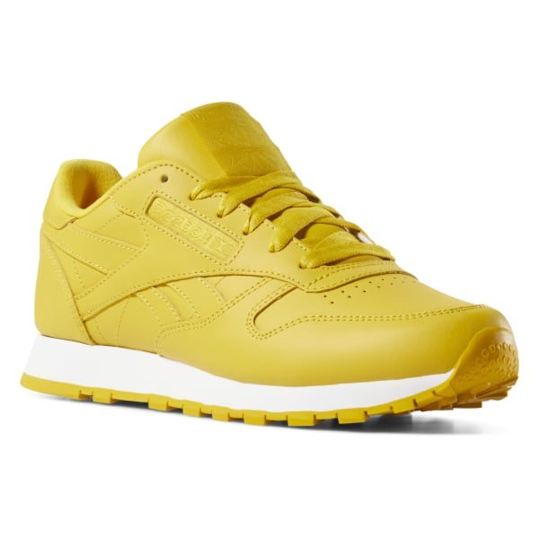 72047bb06e2 Tenis Classic Leather color mid-urban yellow   white CN7604