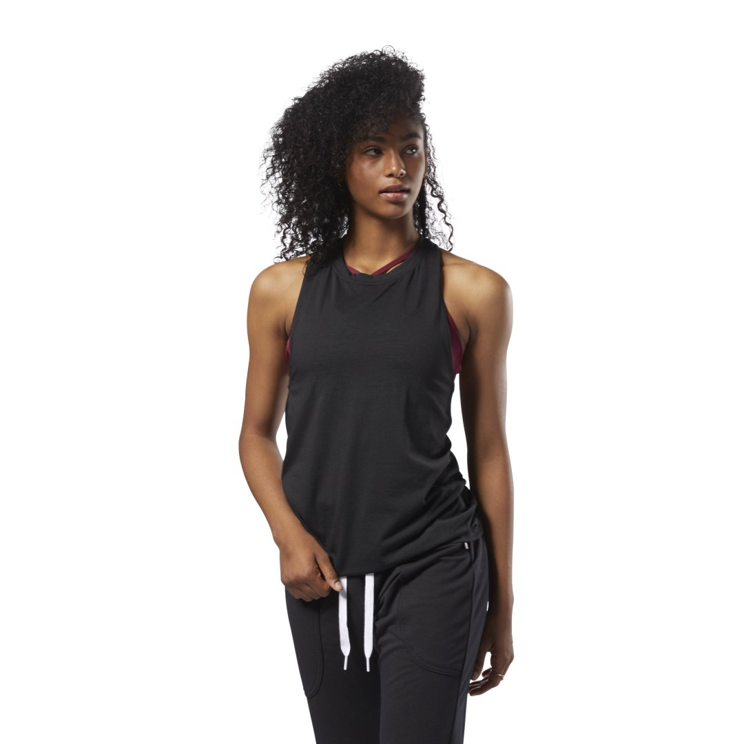 An easy to wear piece,this modern racerback tank is styled in all-over stratified burnout print and a slightly higher neckline for added style and coverage. Speedwick moisture management technology helps keep you dry and comfortable. Subtle Reebok delta b