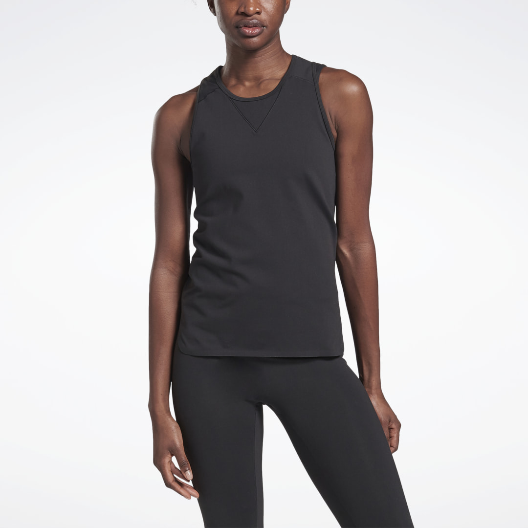 This slim-fitting tank top has minimalist style. Angular Reebok x VB branding flashes on the front. 88% nylon / 12% elastane single jersey Designed for: Any training workout Slim fit Round neck Anti-microbial finish; Bonded seams for a clean look and smoo