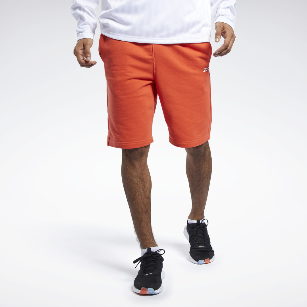 Leg day or any day, these men\'s shorts are built for comfort. They\'re made of a cotton-blend French terry and cut slim for an athletic look. The long length provides extra coverage. A Reebok graphic on one leg adds a bold hit of sporty style. 80% cotton /