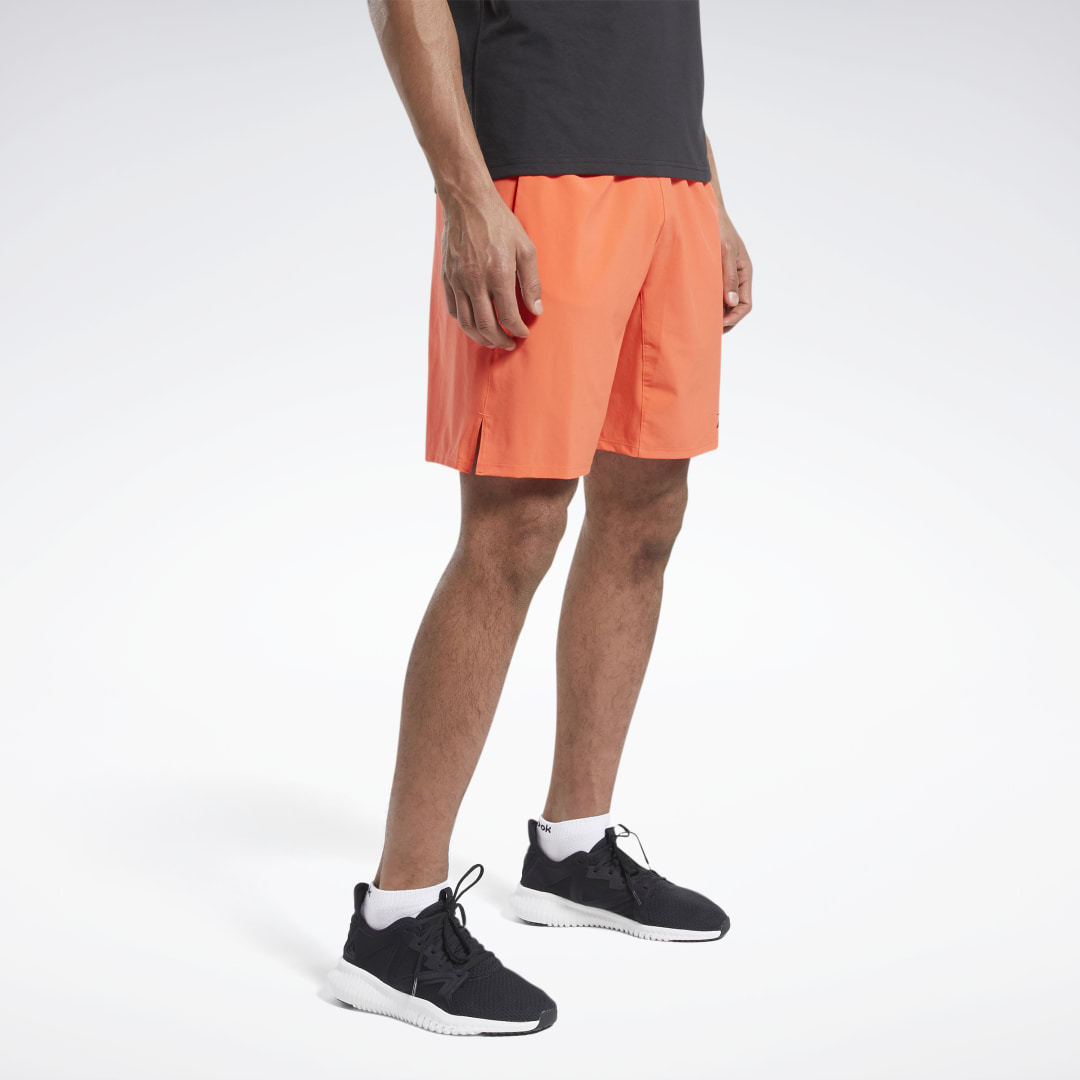 Stretch and squat without distractions. These men\'s training shorts are cut from lightweight and stretchy material and have side hem slits for extra mobility. Sweat-wicking fabric helps pull moisture away from the skin. The drawcord elastic waist keeps th