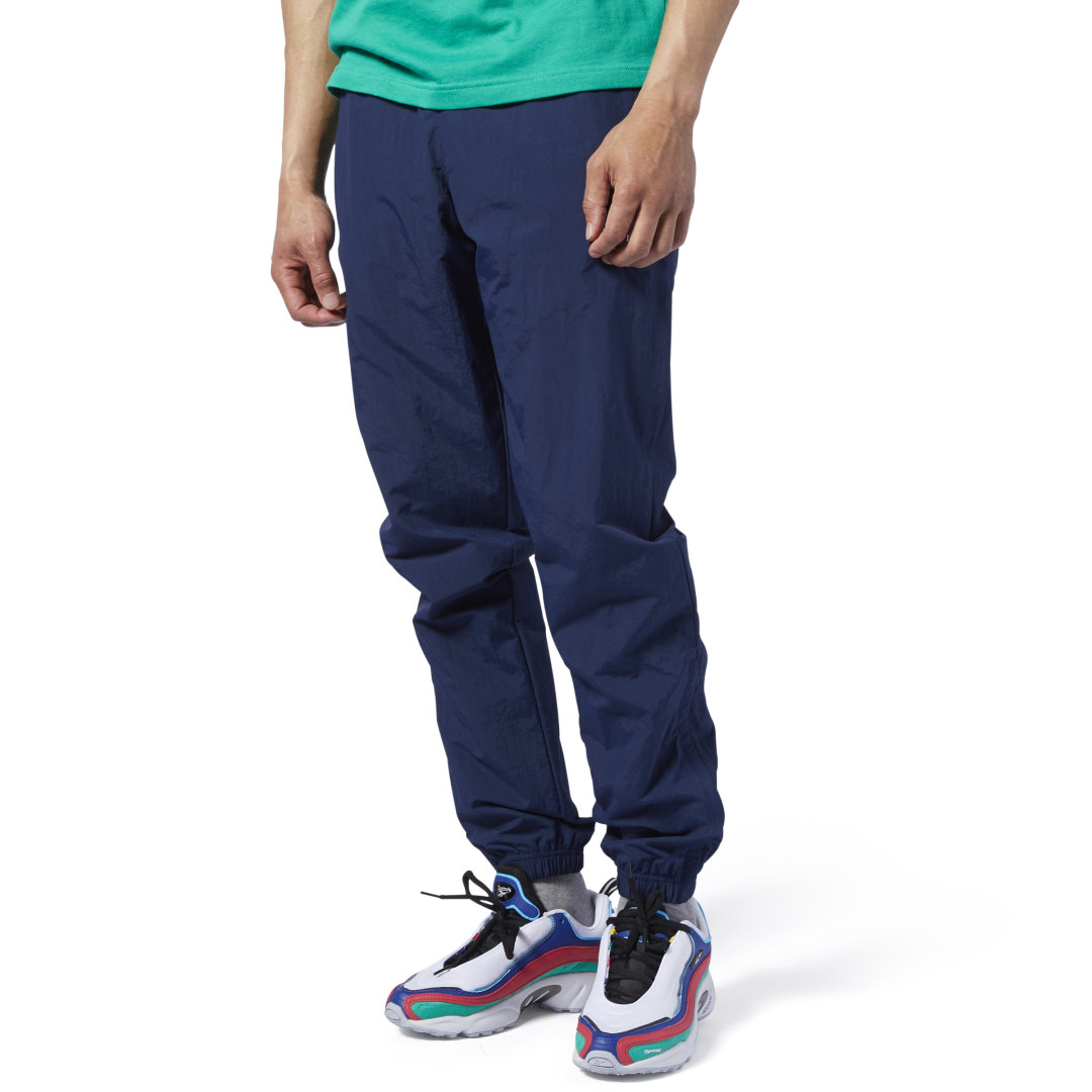 Clean, minimalist style. These slim-fitting track pants have a low-key look. Contrast Vector logos on the ankles add heritage flair, while ankle zips make them easy to slip on and off. Plain weave fabric adds a sleek, structured finish. 100% nylon plain w