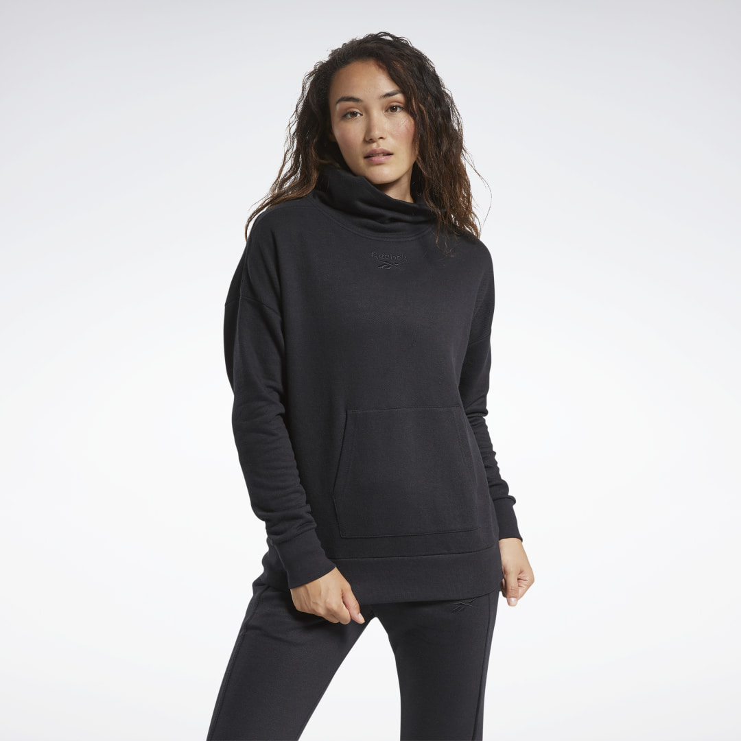 Ready for some lounge time? Pop on this women\\\'s cowl-neck sweatshirt and bring on the toasty warmth. It has a ribbed hem and cuffs for a snug fit. The kangaroo pocket keeps your small essentials close. 65% cotton / 35% polyester fleece Relaxed fit Cowl ne