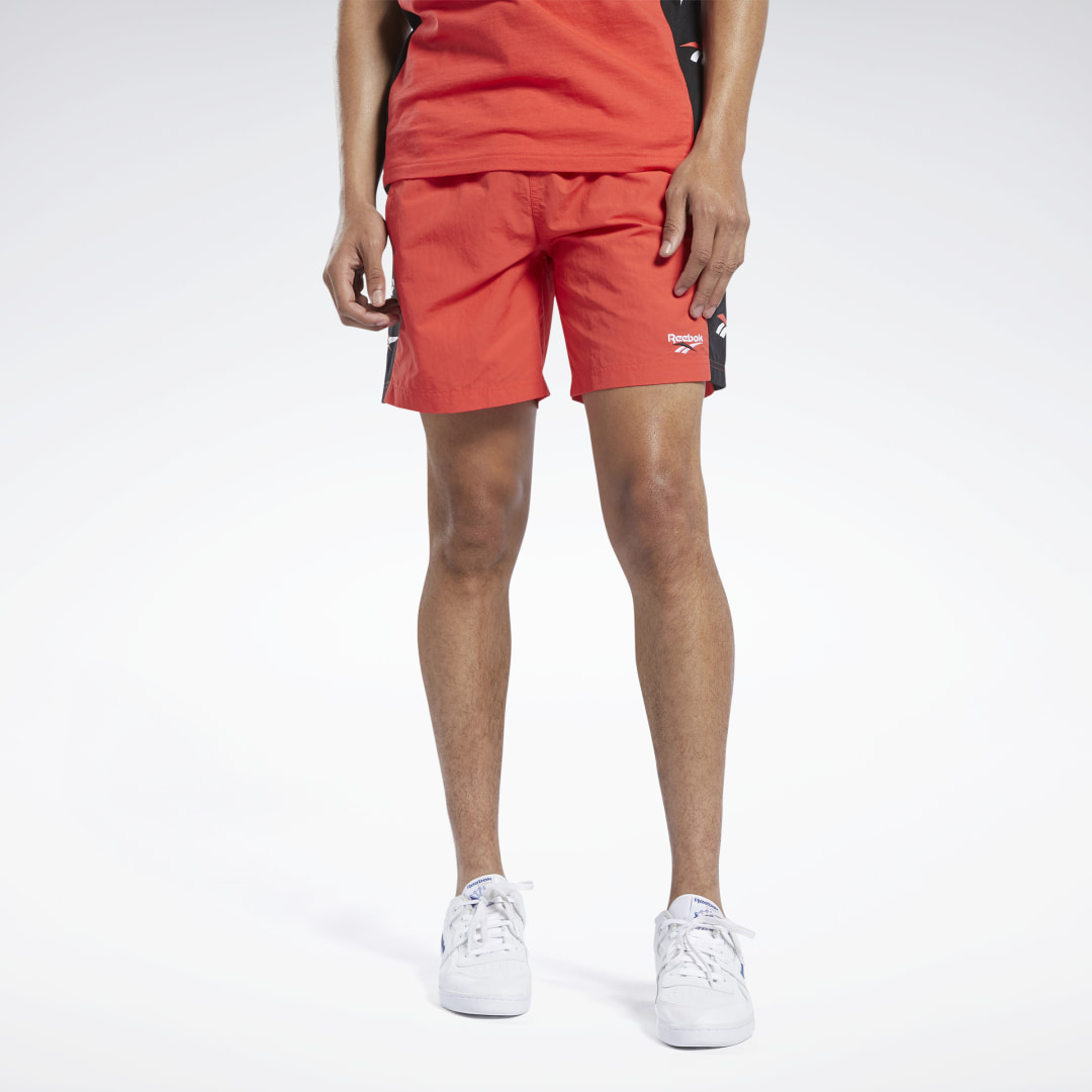 A retro look, remastered for today. These men\'s shorts dial back the clock with vintage-era Vector logos down the sides. The durable woven fabric is smooth to the touch. 100% nylon plain weave Regular fit Drawcord on elastic waist Side slip-in pockets Imp