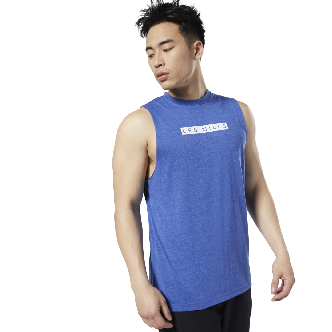 Take your workout outside of the box. Keeping you focused as you push toward your goals, this men\'s tank top features sweat-wicking fabric to help balance heat. A soft cotton build provides extra comfort. 85% polyester / 15% cotton knit Designed for: Any