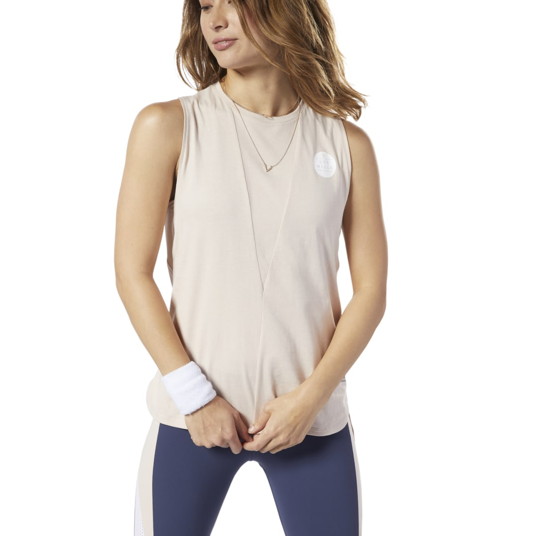 Take your workout to the next challenge. This women\'s tank top has breathable mesh panels to help circulate airflow as the heat builds. It has an elongated back hem for extra coverage as you squat, jump and stretch. 100% cotton jersey Designed for: Traini