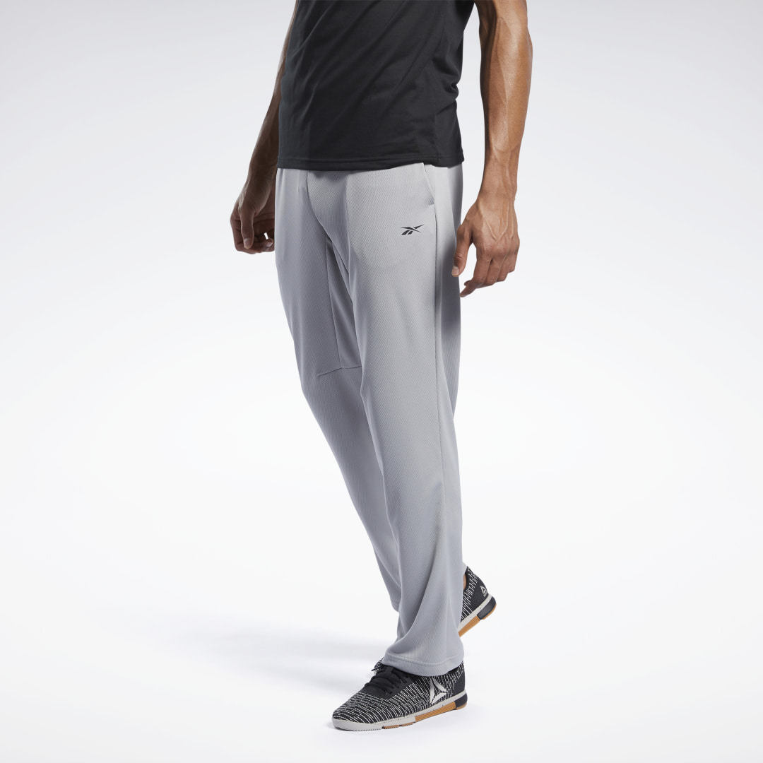 Warm up or cool down. You can wear these track pants during your workout or to and from the gym. The doubleknit build features a regular fit for a casual feel and a leg gusset for freedom to move during your workout. 100% recycled polyester doubleknit Des