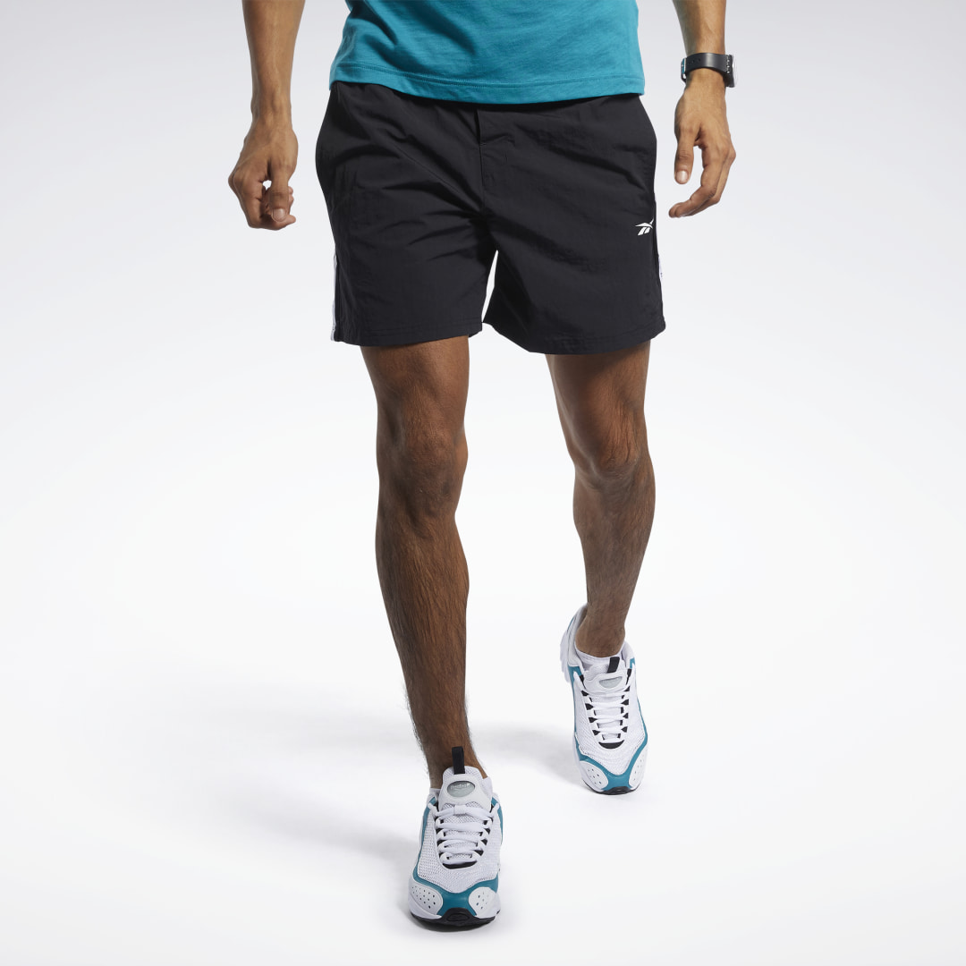 Streamlined style for the gym and beyond. These men\'s shorts are made of nylon woven fabric. The waist has a drawcord and snap-button closure for a stay-put fit. Reebok graphic tape gives them a sporty look. 100% nylon plain weave Regular fit Drawcord on
