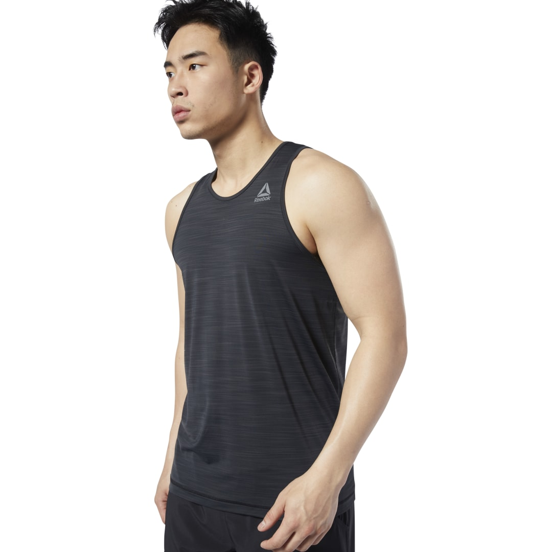 Control your comfort on the weight floor. This men\'s lightweight tank top has a slim fit that doesn\'t get in the way. Sweat-wicking technology keeps you dry and focused, while breathable fabric helps you stay cool even as the heat builds. 84% nylon / 16%