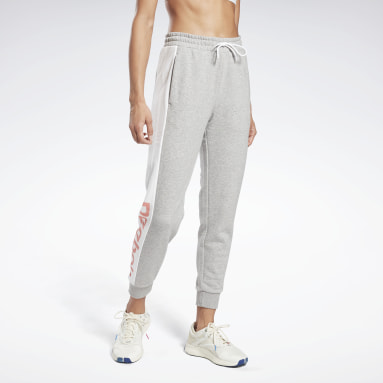 Pantalón Linear Logo French Terry Gris Mujer Fitness & Training