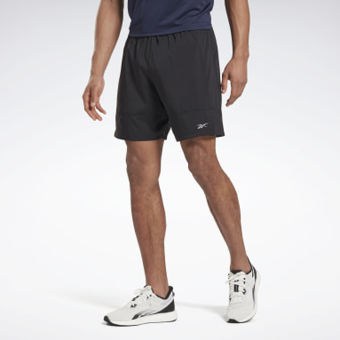 Shorts Running Essentia 7-Inch Woven Negro Hombre Running