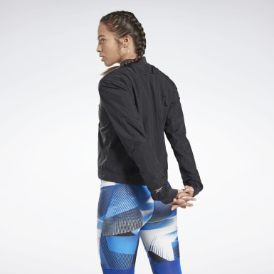 Campera estilo aviador One Series Running Negro Mujer Running