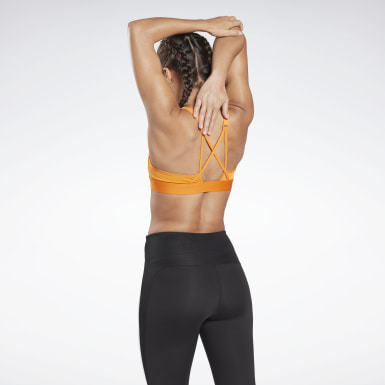Frauen Studio Reebok Hero Medium-Impact Strappy Bra Orange