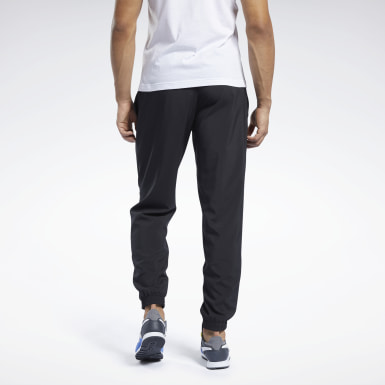 Pantaloni Training Essentials Woven Cuffed Nero Uomo Hiking