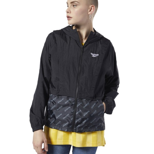 A modern take on a simple classic. This women\'s windbreaker features a tonal monogram print on the bottom for a splash of understated style. The relaxed fit makes it easy to slip on over bulky clothes, while the crinkled nylon fabric gives it a textured look. 100% polyester plain weave Relaxed fit Oversize hood for added coverage Elastic cuffs and hem for a snug fit Side pockets Imported