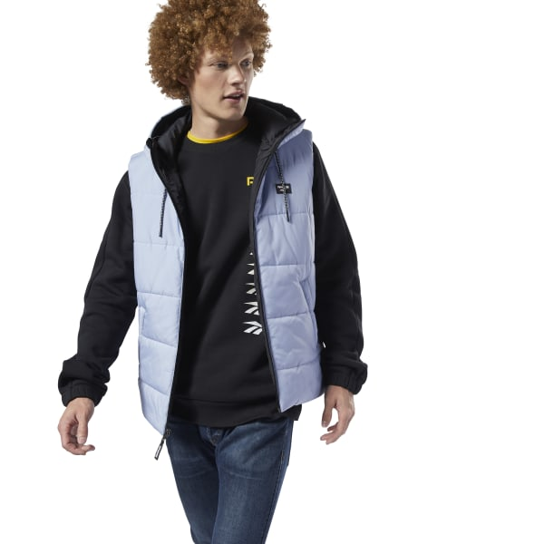 The ultimate in versatility. This men\'s vest features a fully reversible design, so you can wear it two ways. The slim-fitting vest is lightly padded for extra insulation. A clean, minimalist look makes it a go-to style for cool days. Main: 100% polyester plain weave; Padding: 100% polyester Slim fit Reversible construction Drawcord-adjustable hood Front zip pockets Imported