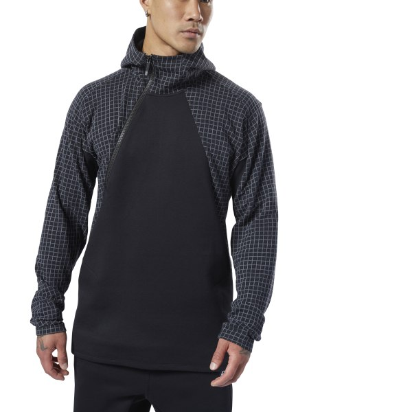 Throw on this men\'s hoodie and go wherever the day takes you. From the gym to post-workout play, the slim-fitting pullover keeps you comfortable in a cozy cotton blend build. Cut with slits on the sides, this top features textured panels and an asymmetrical zip, bringing extra flavor to a casual look. 65% cotton / 35% polyester spacer Slim fit Asymmetric half zip with hood Front pockets Imported