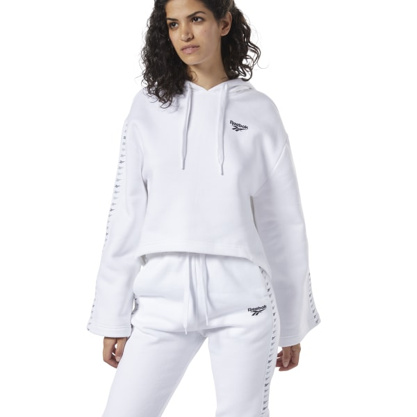 A modern-day take on classic sporty looks. This women\'s hoodie shows off Reebok pride with Vector graphics on the sleeve and chest. Batwing sleeves create a free-flowing vibe, while the soft fleece build keeps it a cozy. 80% organic cotton / 20% polyester fleece Oversize fit Drawcord-adjustable hood Wide sleeves Repeating Vector graphic down right sleeve Imported