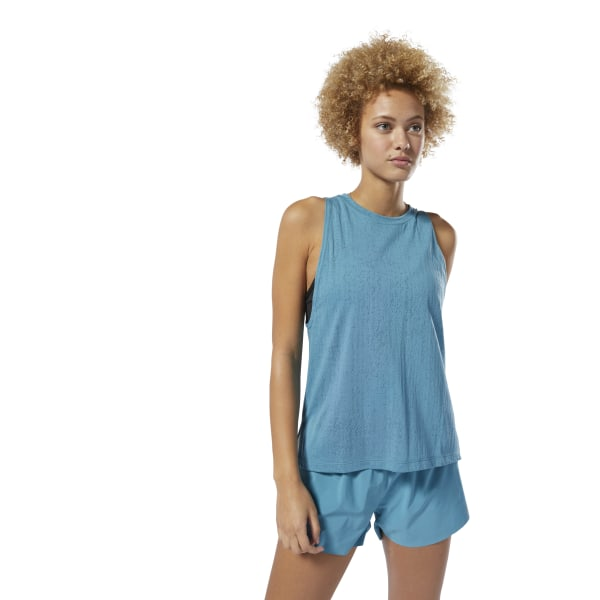 Designed for cool, dry comfort, this women\'s training tank top is made with Speedwick fabric that keeps moisture away from your body. A high neckline, drop armholes and burnout jersey fabric give it a modern look. The longer back length provides extra coverage as you move. 54% polyester / 24% cotton / 22% viscose single jersey Designed for: Training or any other workout Regular fit Speedwick fabric wicks sweat to help you stay cool and dry High neckline and droptail hem for added style and coverage Drop armholes for easy layering Imported