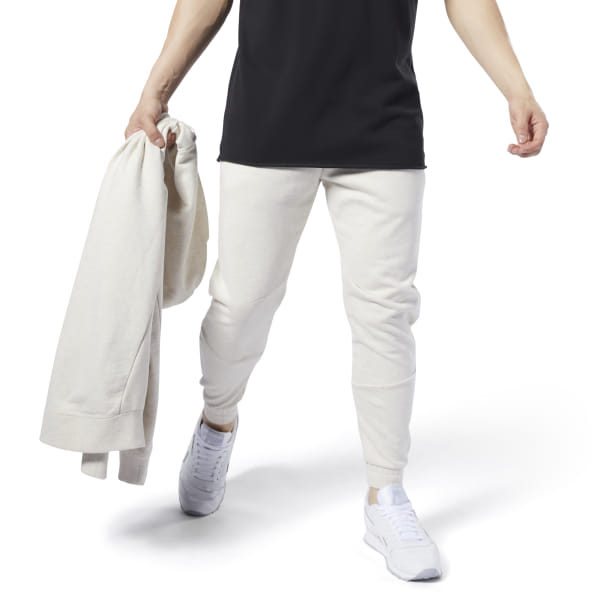A classic look remastered. These men\'s joggers are made of soft, heavyweight cotton for enhanced, everyday comfort. Cut to stay close to your body, they\'re built with banded cuffs and an elastic waistband for a snug, secure fit. A slight drop crotch and tapered legs keep them modern. Concealed zip pockets store your essentials. 100% cotton French terry Designed for: Warmups Slim fit Elastic waist for a secure fit Concealed zip side pockets for storing essentials Sight drop crotch and tapered legs; Cuffed hems for a secure fit Imported