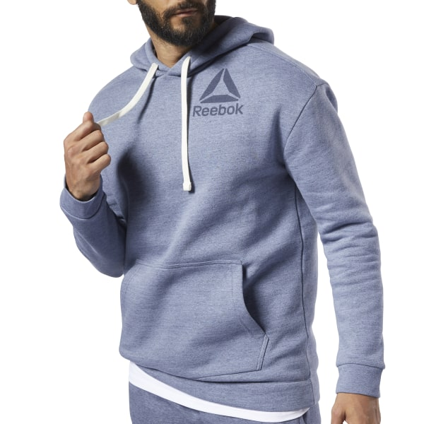 Throw this men\'s hoodie on over anything and you\'re good to go. It\'s made of a soft, cozy fleece in a fit that\'s not too baggy or too slim. This easy-to-wear style is an everyday essential. 70% cotton / 30% polyester fleece Regular fit Drawcord-adjustable hood; Kangaroo pocket Ribbed cuffs and hem; Side vent overlap Reebok graphic Imported