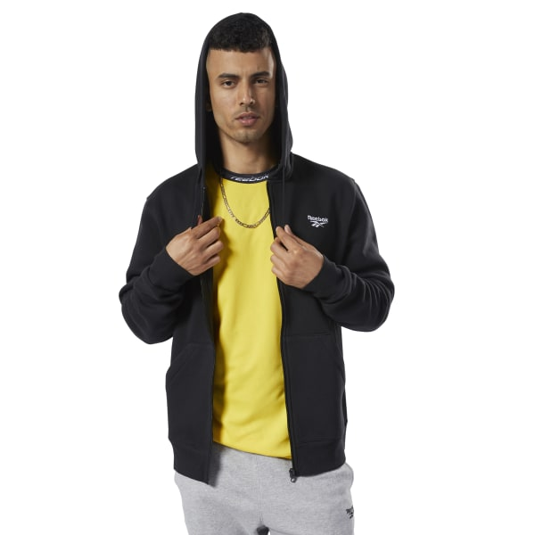 No-nonsense sporty style. This men\'s easygoing hoodie has a clean look. The contrast logo on the chest is small and understated. It\'s made of a cozy fleece for a soft feel. 80% organic cotton / 20% polyester fleece Regular fit Kangaroo pockets Ribbed sleeve panels This sweatshirt is made with organic cotton to save water and conserve energy Imported