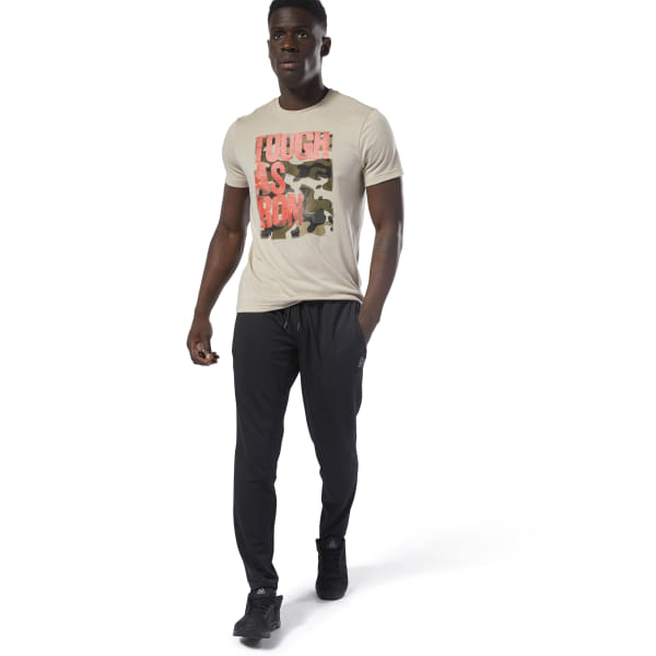 Hit the gym or the track in these men\'s training pants. They\'re cut in a slim fit and made with Speedwick fabric to manage heat and moisture. Knee gussets with angled side seams let you move with ease. 100% recycled polyester doubleknit Designed for: Training Slim fit Speedwick fabric wicks sweat to help you stay cool and dry Hand pockets for essentials Drawcord on waist for adjustability; Tapered legs; Gusset with angled side seams at the knees for comfort and mobility Imported