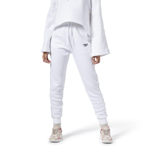 These women\'s pants have a style rooted in \'90s motor sports. They\'re made of soft fleece for an extra-cozy feel. Graphic tape on the legs with gradient Vector logos gives them a modern racing vibe. 80% organic cotton / 20% polyester fleece Slim fit Side slip-in pockets Drawcord on elastic waist for adjustability Ribbed cuffs for a snug fit Imported