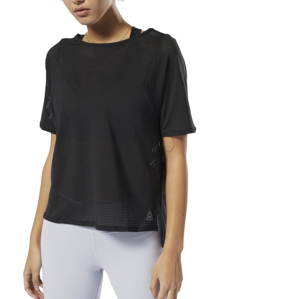 Meet the demands of your workout in the modern style of this women\'s t-shirt. The sweat-wicking fabric helps you stay cool and dry, and the perforated design offers supreme breathability during high-impact training. Slits on the side let you move freely, and the elongated hem adds extra coverage. 84% recycled polyester / 16% spandex single jersey Designed for: Training workouts Relaxed fit Speedwick fabric wicks sweat to help you stay cool and dry Side-split droptail hem Imported