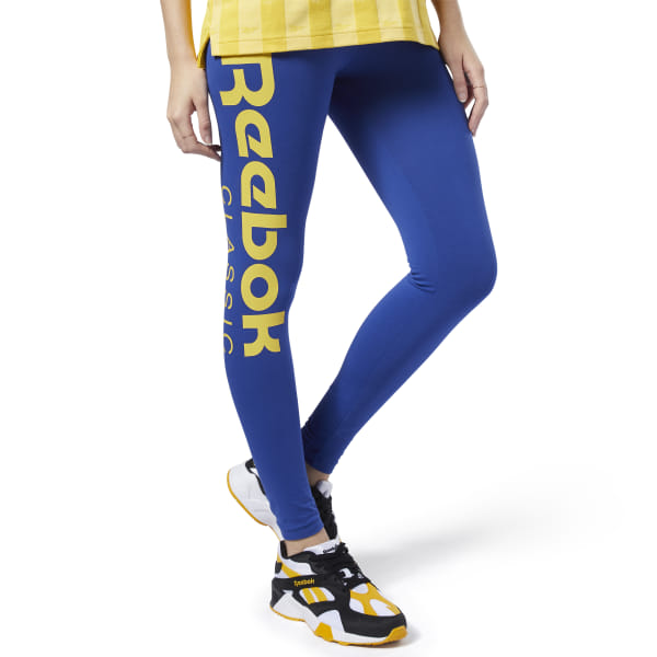 A modern take on an everyday essential. A big, asymmetrical logo in a contrast color adds flair to these women\'s leggings. The elastic waist and stretchy cotton jersey build makes them feel soft and comfortable. 92% cotton / 8% elastane single jersey Fitted fit Elastic waist for a snug fit Reebok graphics on legs We partner with the Better Cotton Initiative to improve cotton farming globally Imported