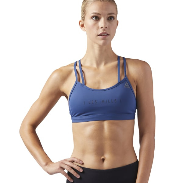 47df86a061 Reebok LES MILLS® HERO Padded Strappy Sports Bra - Blue | Reebok US