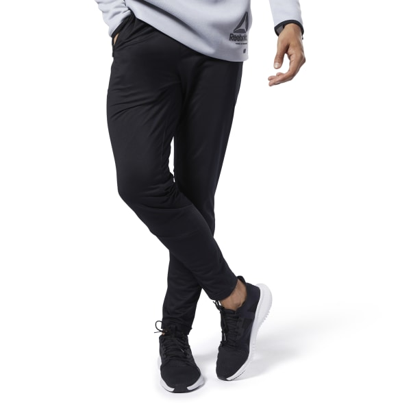 Run through your pre-workout routine in the comfort of these men\'s pants. The sleek pants are made in smooth tricot with a slim fit. Sweat-wicking fabric keeps you cool and dry as your muscles start to warm up. 100% polyester tricot Designed for: Warm-ups Slim fit Speedwick fabric wicks sweat to help you stay cool and dry Front zip pockets Drawcord-adjustable waist Imported