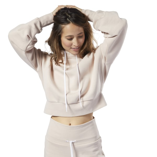 Master the barre-to-brunch look. The loose shape of this women\'s hoodie makes it easy to comfortably layer over your workout clothes. It\'s made of cotton with a vintage wash for a supersoft, worn-in look and feel. 80% cotton / 20% polyester fleece Relaxed fit Drawcord-adjustable hood Ribbed cuffs and hem We partner with the Better Cotton Initiative to improve cotton farming globally Imported