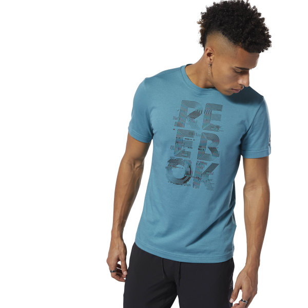 The future is here. This men\'s tee is made of lightweight cotton for daily comfort. The graphic flashes forward on Reebok tradition. 100% cotton single jersey Slim fit Crewneck Short sleeves Reebok graphic by artist Alex Trochut Imported