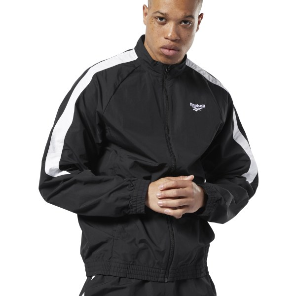 Timeless looks never fail. Contrast color on the sleeves and a stand-up collar give this men\'s track jacket a retro vibe. It\'s made of a durable plain weave fabric for a crisp feel. 100% nylon plain weave Regular fit Stand-up collar Front pockets Imported