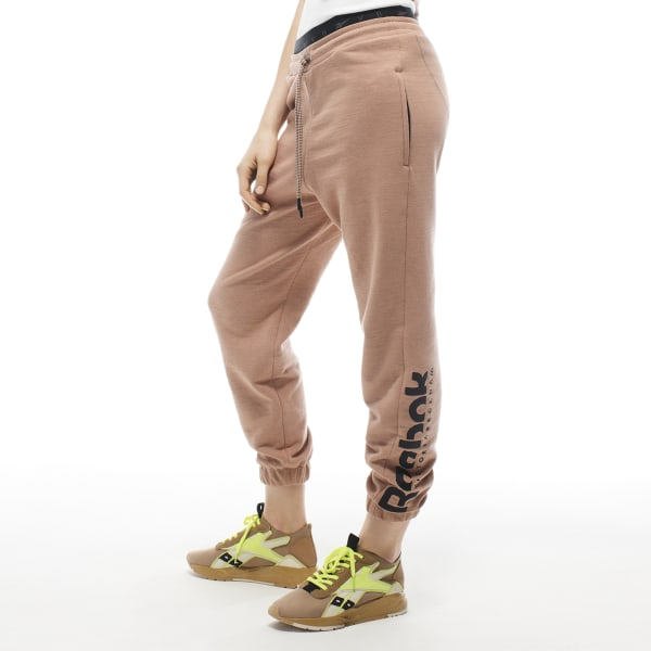 These slim-fitting joggers are made with premium French terry cotton. Featuring zip pockets and a large embroidered logo on the left leg. 100% cotton French terry Designed for: Lifestyle and everyday wear Slim fit Fashion product sizing runs smaller than traditional Reebok product; check size chart for details Side zip pockets for secure storage Exposed branded jacquard elastic waist with drawcord; Elastic cuffs; Slight drop crotch Imported