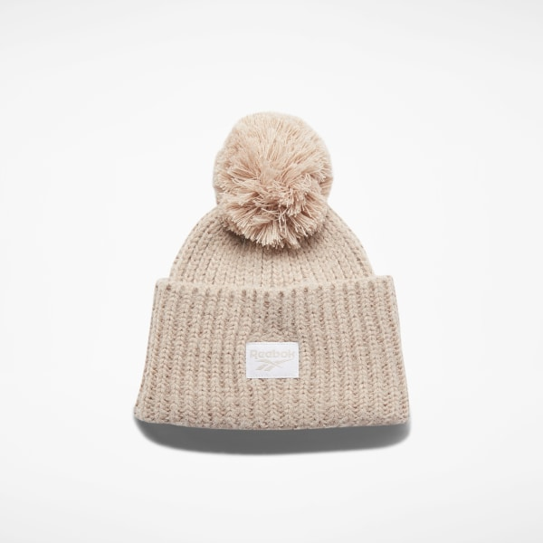 Vintage style inspires this women\'s beanie. This soft hat has a double-layer build for a soft, warm feel. A Reebok Starcrest logo label and a pompom put the finishing touches on a throwback look. 64% polyacrylics / 36% nylon Loose fit Double-layer construction for warmth Pompom on top Imported