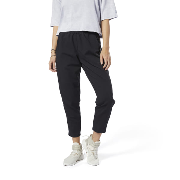 Head to the studio in sport-inspired style. These women\'s pants refresh a track silhouette with a sleek, sophisticated twist. Made of textured fabric, they\'re detailed with a contrast stripe and an exposed waistband. 100% polyester woven Regular fit Exposed elastic waist Front pockets Contrast side-seam stripe Imported