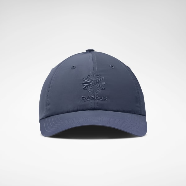 A timeless look gets an upgrade. This women\'s cap is made of suede for a touch of style. A subtle tonal Reebok Starcrest logo sits front and center. 100% polyester D-ring closure Inner sweatband absorbs moisture Imported