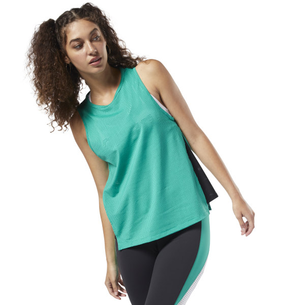 Intensity rises. Stress drops. Find focus as you power through tough workouts in this women\'s tank top. The lightweight tank circulates airflow with a perforated build and breathable mesh inserts on the sides. Sweat-wicking fabric helps keep you cool and dry as you put in dedicated time at the gym. 84% polyester / 16% elastane mesh Designed for: Training workouts Regular fit Speedwick fabric wicks sweat to help you stay cool and dry Breathable perforated fabric for tough workouts Mesh inserts on sides; Droptail hem Imported