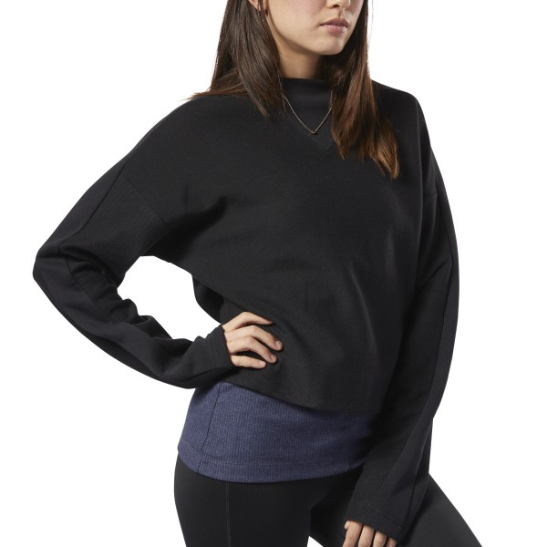 A fresh take on the cowl neck gives this sweatshirt extra style. This women\'s sweatshirt is made of soft cotton twill with a relaxed fit for all-day comfort. The V-shaped French terry cowl neck and drop shoulders add casual, standout style. 100% cotton twill; French terry cowl neck and panels on the front and sleeve Relaxed fit Cowl neck with V-shaped front insert Drop shoulders Imported