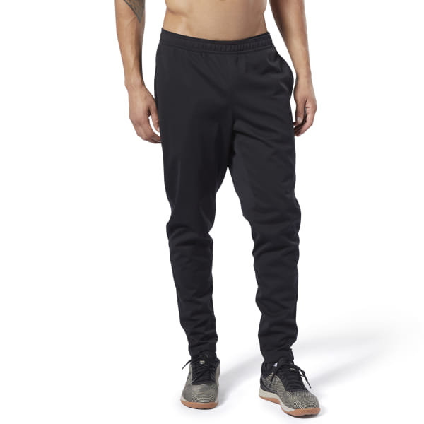 When the farmer\'s carry takes you around the block in blowing snow or cold wind, these men\'s joggers keep you warm and covered. They\'re made of a sturdy cotton-blend doubleknit fabric that wicks moisture away from your skin. Articulated knees allow freedom of movement on lunges and squats. 63% cotton / 37% elastane doubleknit Designed for: CrossFit Created using data collected from thousands of elite and everyday CrossFit athletes, this fit is tailored specifically for the body shape of CrossFitters Speedwick fabric wicks sweat to help you stay cool and dry Front zip pockets; Drawcord on waist for adjustability Gussets on inner legs; Articulated knees for ease of movement Imported