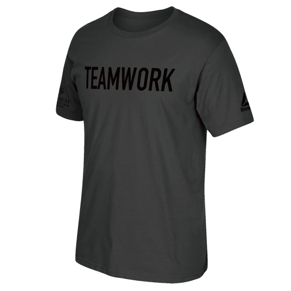 It\'s all about teamwork. Pull on this men\'s tee and show your support for the Navy SEAL Foundation. It\'s made of 100 percent ring spun cotton for a soft feel, and features front and back graphics. 100% ring spun cotton knit Designed in collaboration with the Navy SEAL Foundation.The official tee of the Navy SEAL Foundaton\'s TEAMWORK event. Short sleeve crewneck Reebok branding on left sleeve; Navy Seal Foundation logo on right sleeve Front and back graphic Imported