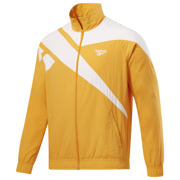 You\'ve found it. Brought forward from the vault, this �90s-inspired zip-up jacket is perfect company for warming up a jeans ensemble or pairing with our Vector Track Pants to complete the heritage look. Reebok�s iconic vector logo sweeps across the shoulders for a bold refresh of an era-spanning classic. 100% Nylon, plain weave fabric for classic comfort Relaxed Fit - wears looser for traditional comfort and style Full-zip front with vector branded zipper pull Elasticated cuffs and hem for a stay-put fit Front pockets for storage Cut-and-sew vector panels and raglan sleeves for an authentic vintage look Imported