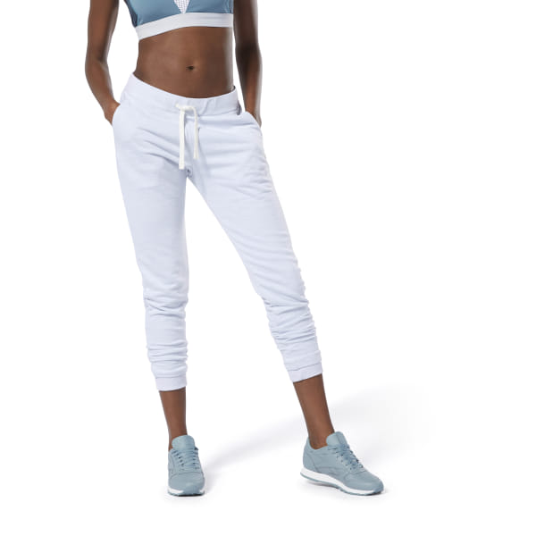 Whether you\'re warming up at the gym or lounging around afterward, these women\'s training pants transition with you throughout your day. They\'re made from French terry for a modern, slim fit. The marble m�lange fabric adds subtle style. 70% cotton / 30% polyester French terry Slim fit Drawcord on ribbed waist Side pockets Ribbed cuffs Imported
