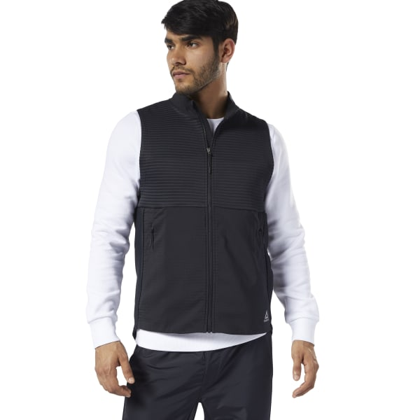 Chase PRs on crisp mornings in this men\'s running vest. This vest has lightweight insulation for temperature management in cold weather. Front pockets are for keeping workout essentials close at hand. 73% polyester / 27% recycled polyester Designed for: Cold-weather running and workouts Regular fit Thermowarm Deltapeak layered insulating fabric with polyester fill creates lightweight warmth Thermowarm materials help you find the right balance to remain warm and dry in cold weather conditions Front pockets; Full zip Imported