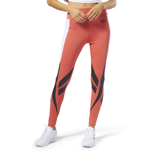 Archive \'90s-era designs inspire these women\'s leggings. Stylized Vector graphics and angled blocks of color give them a retro vibe. The leggings are made of a stretchy interlock fabric for added comfort and mobility. 91% polyester / 9% elastane interlock Fitted fit Vector graphics on legs Imported