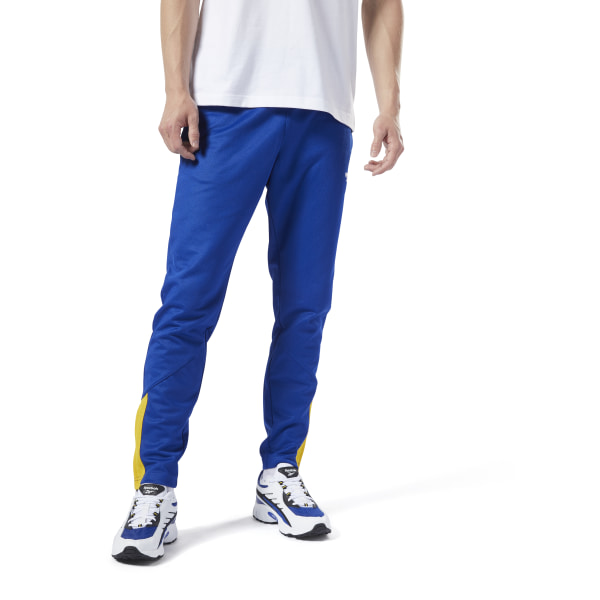 Retro motorcycle racing style inspires these men\'s pants. They\'re made of blended cotton for everyday comfort. The slim fit gives them a flattering shape, while ankle zips allow for versatile wear. Leave the legs relaxed or zip up the bottoms for a tapered look. 52% cotton / 48% polyester doubleknit Slim fit Tapered legs Side slip-in pockets Closed hem with ankle zips for versatile wear Imported