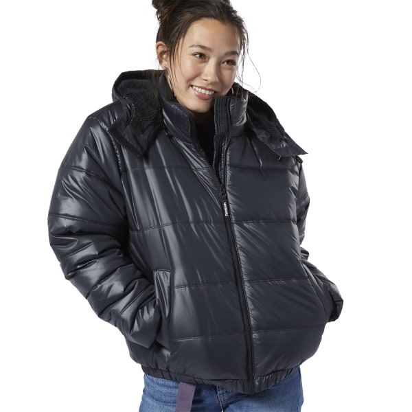 Classic winter looks meet street style. This women\'s bomber jacket is padded for lightweight insulation. The adjustable hood has faux fur trim. Ribbing at the cuffs and an elastic hem helps keep out the cold. A subtle logo is stitched onto the back for a sporty vibe. Shell: 56% recycled polyester / 44% polyester woven; Lining: 100% polyester; Filling: 100% polyester padding Oversize fit Side pockets Faux fur hood lining with drawcord for adjustability Full zip Imported